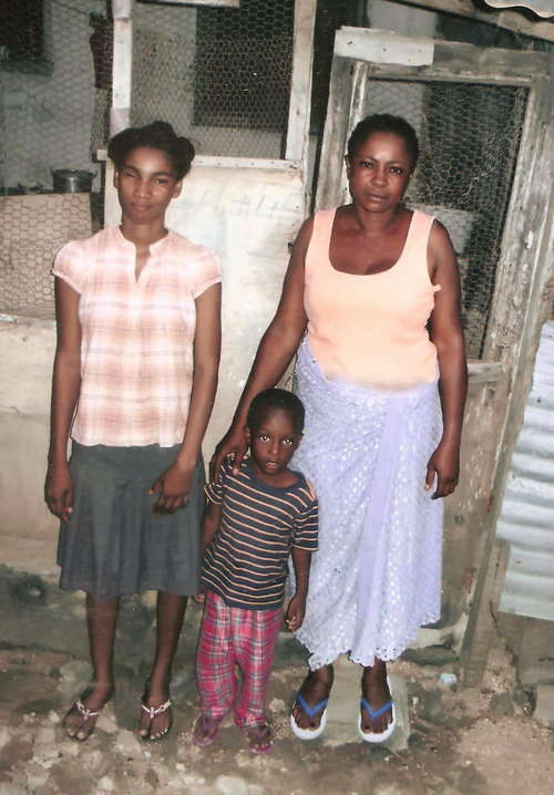 Grace with her children at the camp