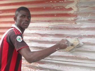 Jeremiah Gaye working at renovations.2 jpg