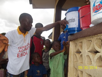 Showing the Children how to hand wash