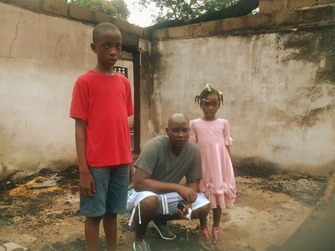 Victor Kpakima with his 2 children