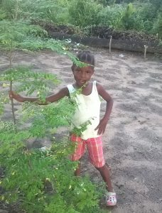 bernice-stands-by-moringa-tree