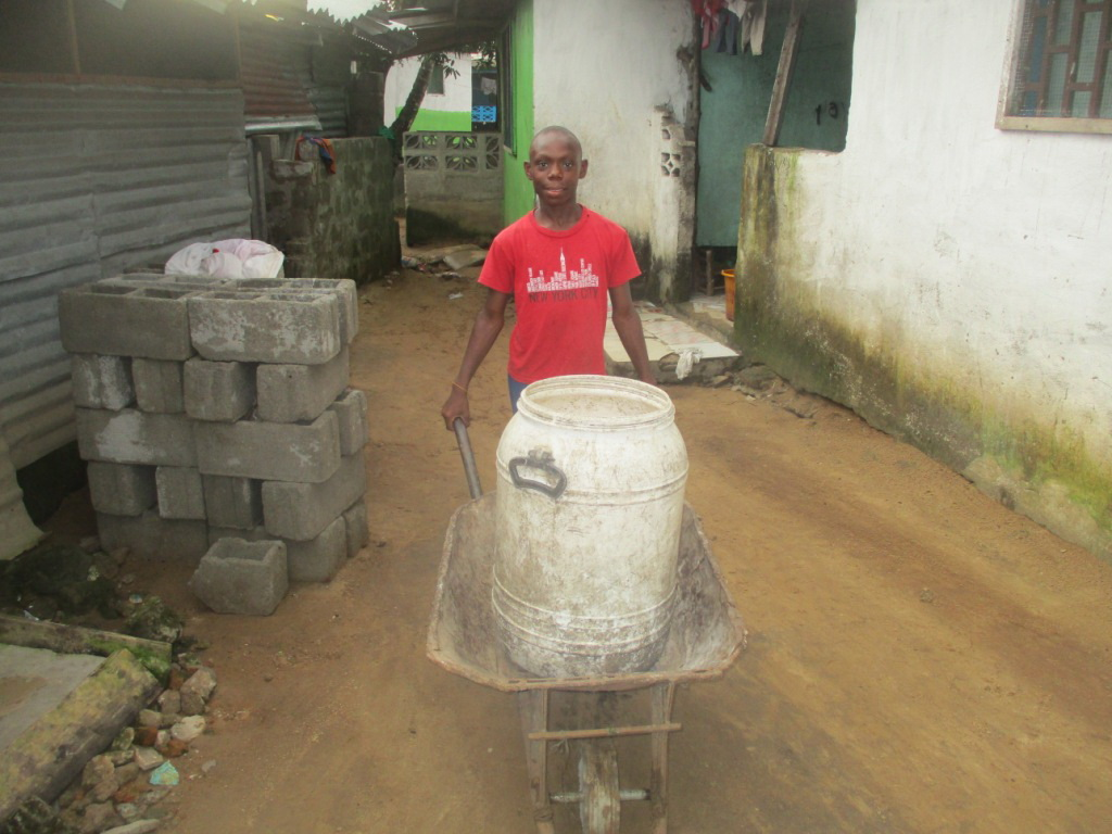 Otis Jallah helps his family every day by collecting local garbage and getting paid. His profits are very little, but it helps feed his family.