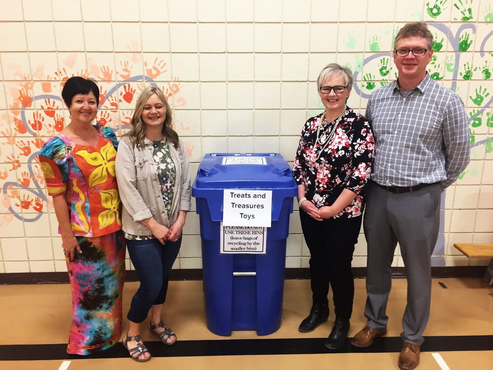 Principal Joe Thiessen at assembly with Karen Barkman CEO of Provision of Hope. Elaine Peters and Audrey Kampen, are both teachers who are very involved in organizing these events.
