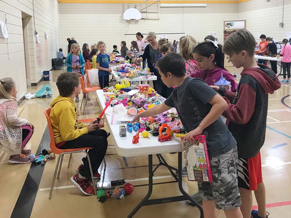 """Grade 4 students are the """"cashiers"""" at the tables."""