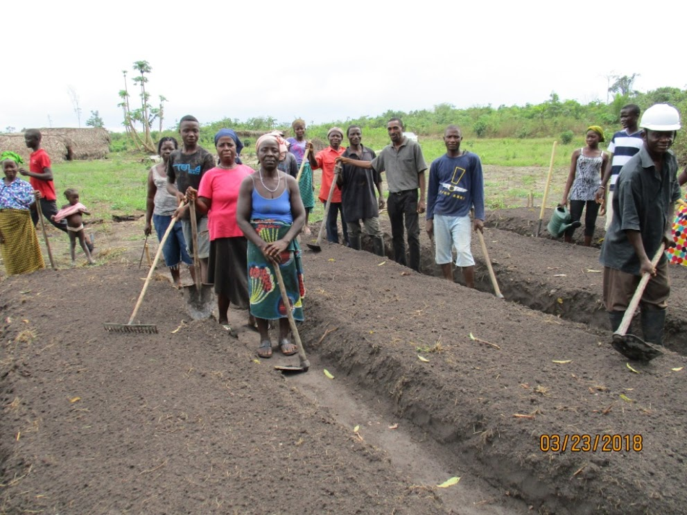 Workshop Day 3 teaching farmers how to prepare the soil. They learn how to compost, how to rotate crops, how to add nutrients.  Later they learn how to plant seeds.  Some seedlings need the shelter of a nursery.  So they built nurseries.
