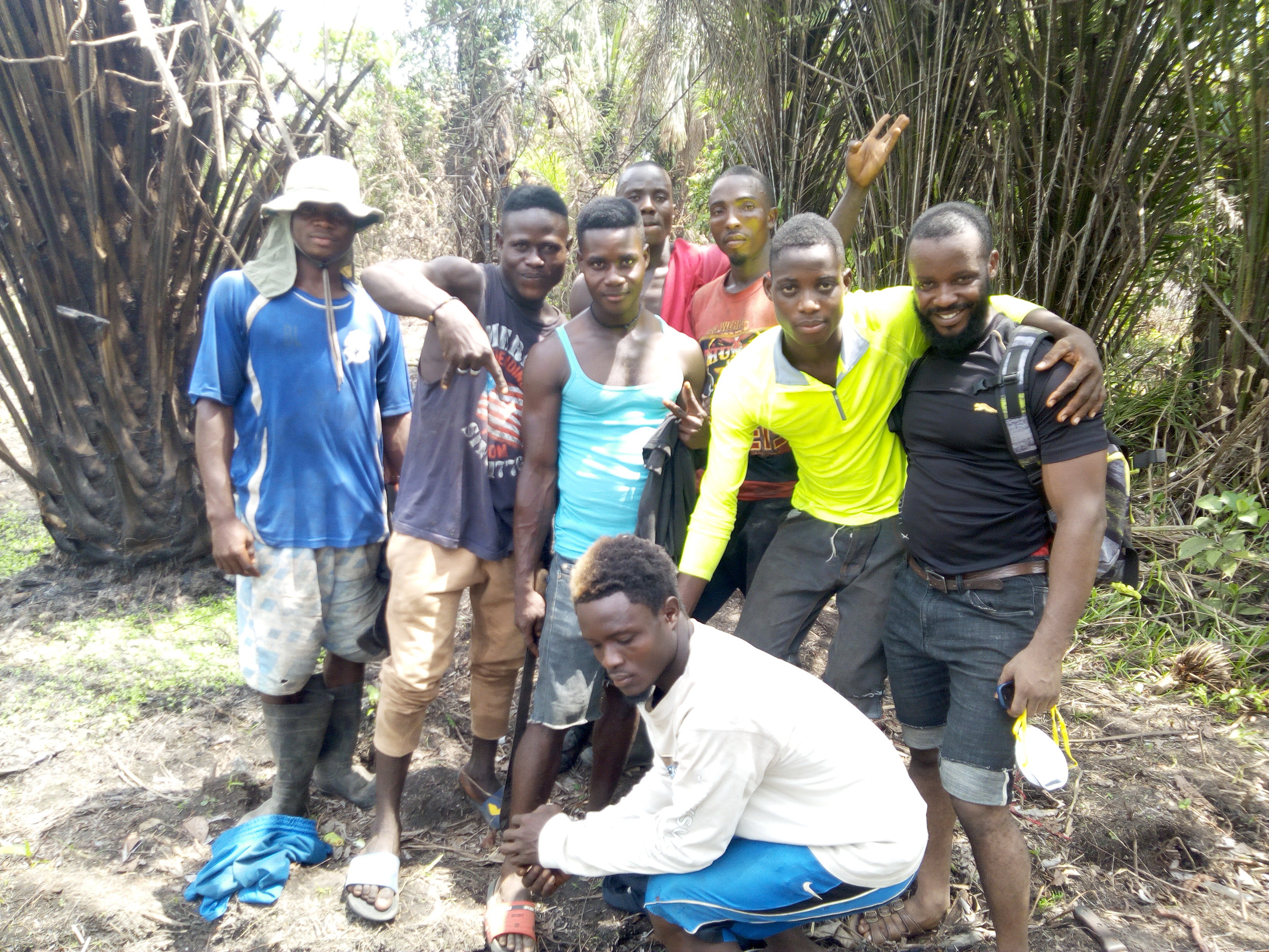 This is a photo of some of the local workers hired to help clear land and help carry bamboo poles to build the nursery.
