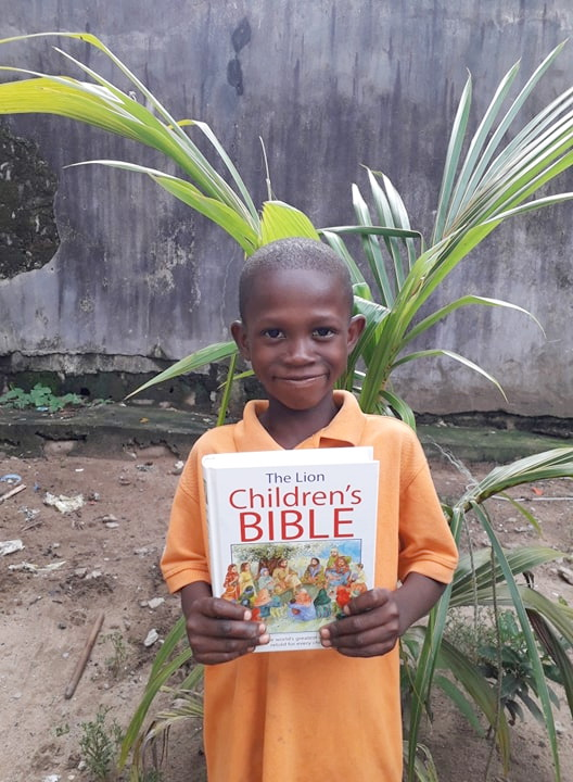 Philemon is holding his new Children's Bible.