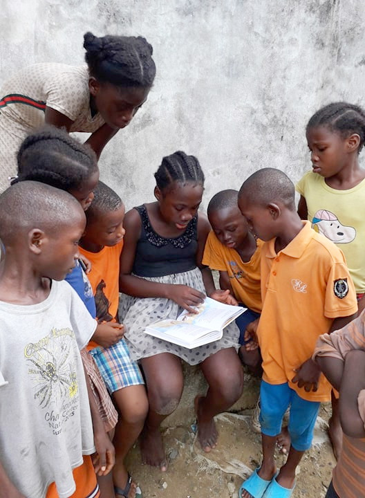 Janet Mulbah is in Grade 8 and can read the Children's Bible to the children in her community.