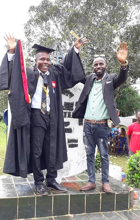 Emmanuel with Daniel Coleman at grad