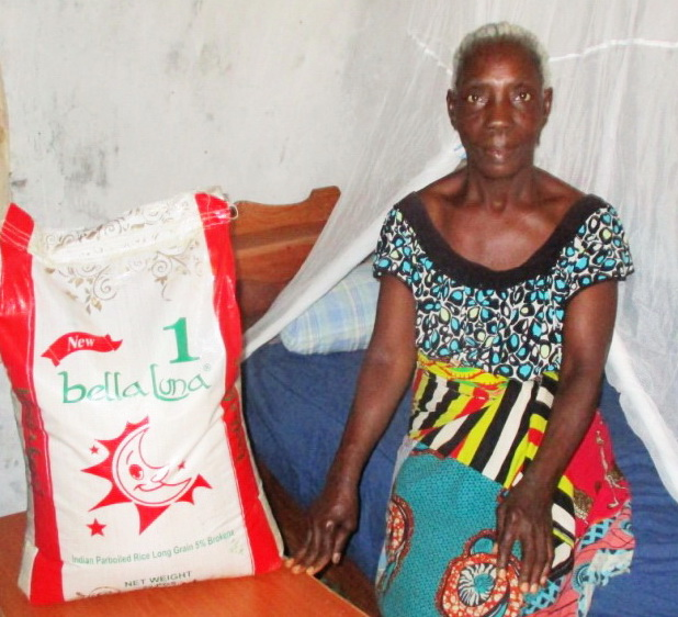 A bed, a mattress, blankets, pillows and a night table for a widow on the floor.  $ 300. Add a bag of rice $ 35
