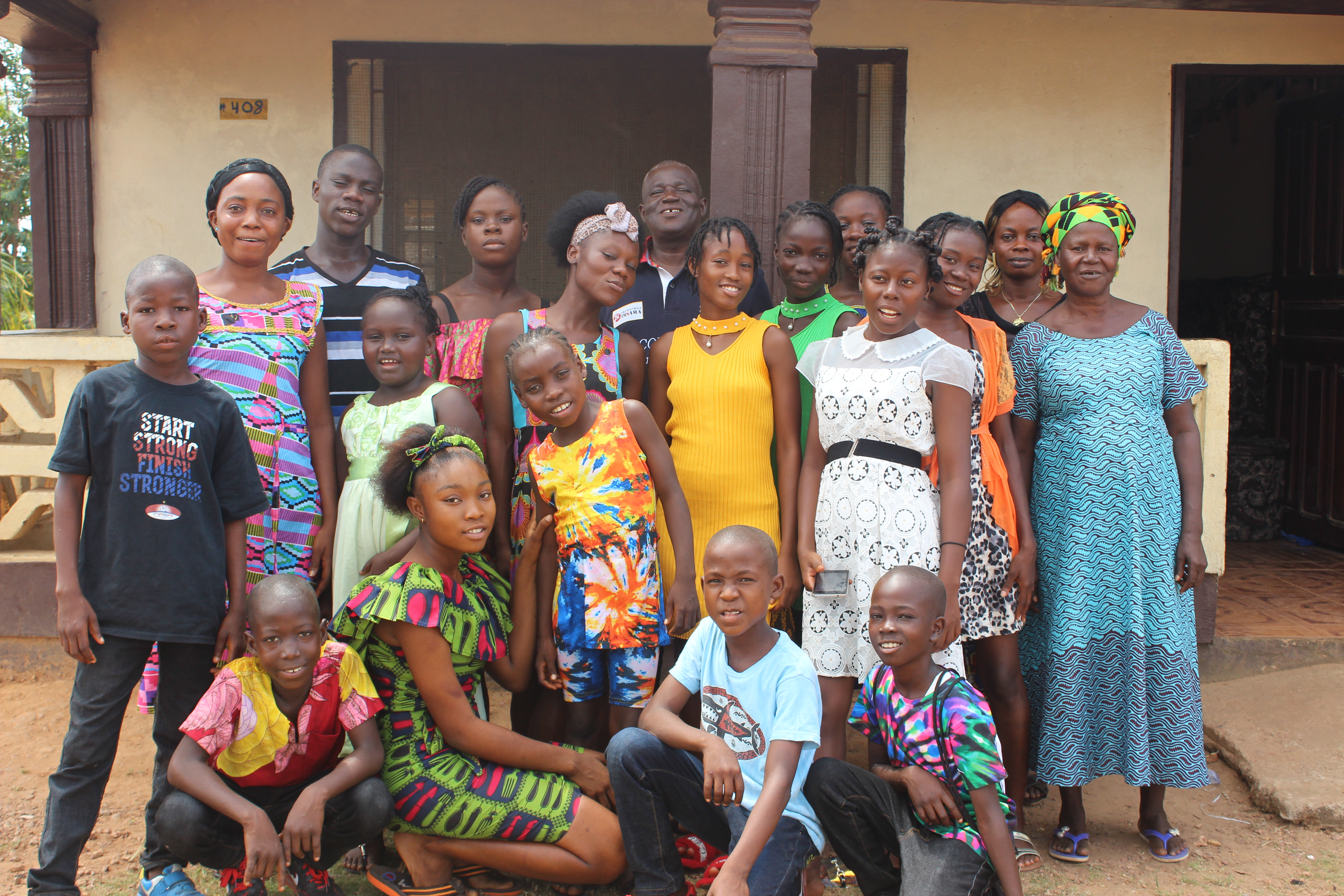 Benetta with their children in Buchanan. We also honor Ma Nyondaynieh, Otis' sister who is also a mother in this home and a very big help!