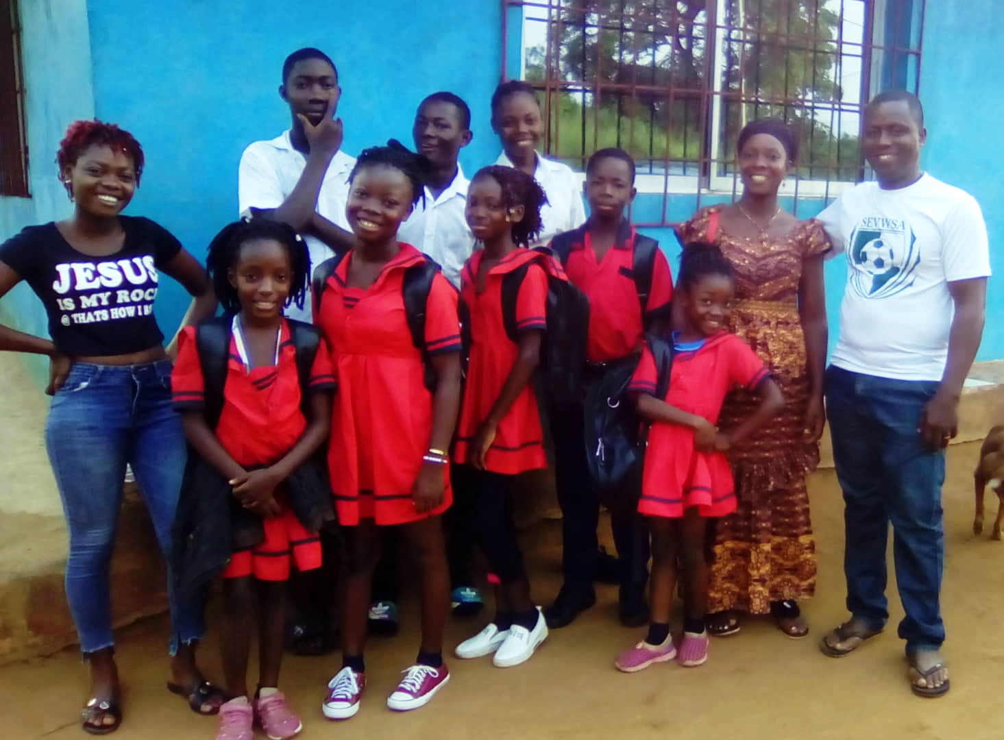 Rita and Dapae with their children in their school uniforms.  A couple are missing from this photo.  They were off to school early.