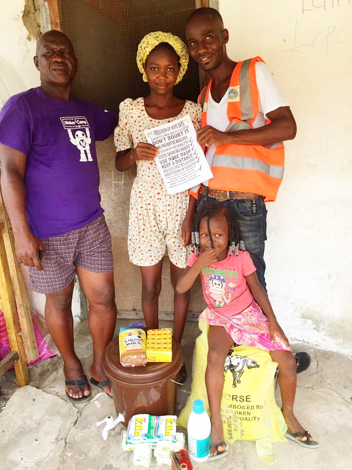 Daniel Coleman delivers food and sanitizing materials to Bendu Kollinson and her uncle.