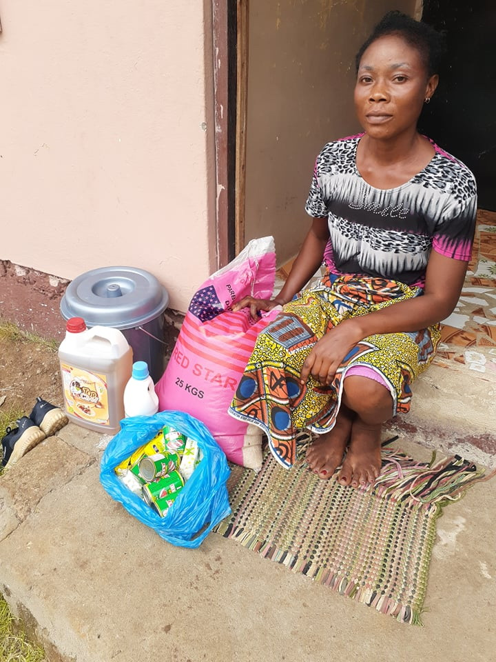 Naomi and her 4 children were happy to get food supplies.  They were out too.