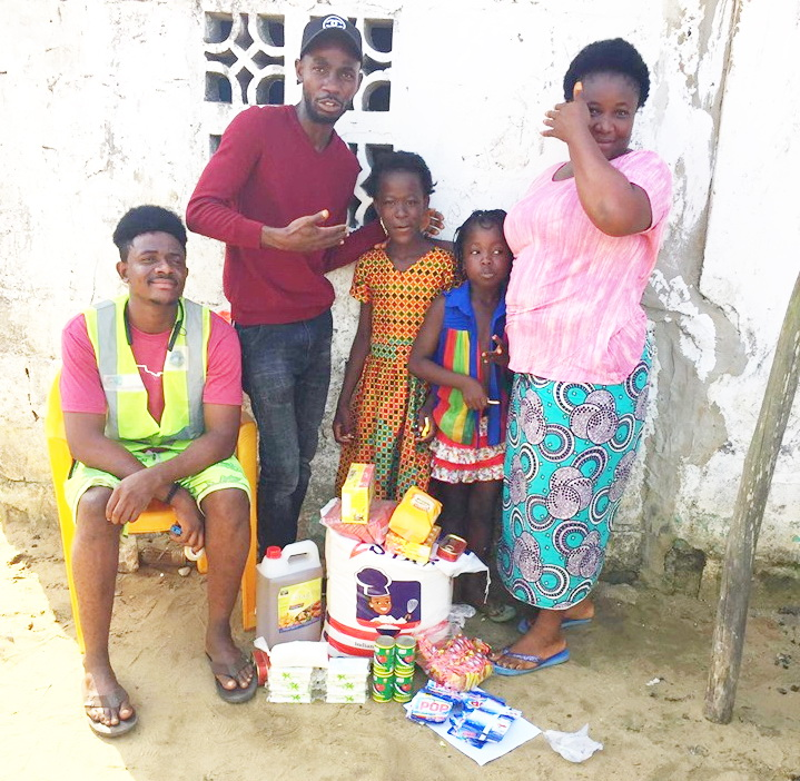 Daniel Coleman and Jeremiah Gaye take a $ 50 package of food supplies to Francess and her girls.