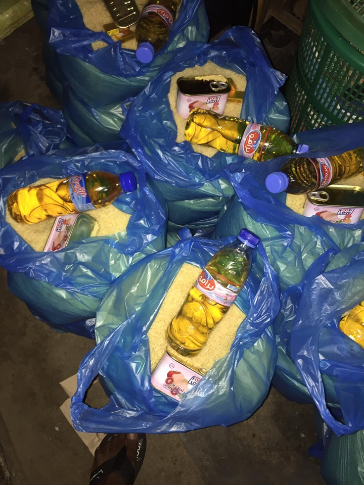 Each bag contained 14-15 cups of rice, a bottle of vegetable oil, a can of chicken, 3 vita cubes and a package of biscuits.