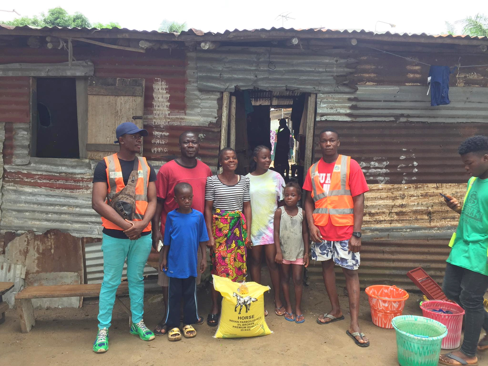 Daniel Keamue with our volunteers distributing rice to a needy family in the slums near Matadi.