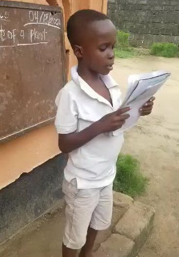 Sammy is reading what he wrote for his answers.