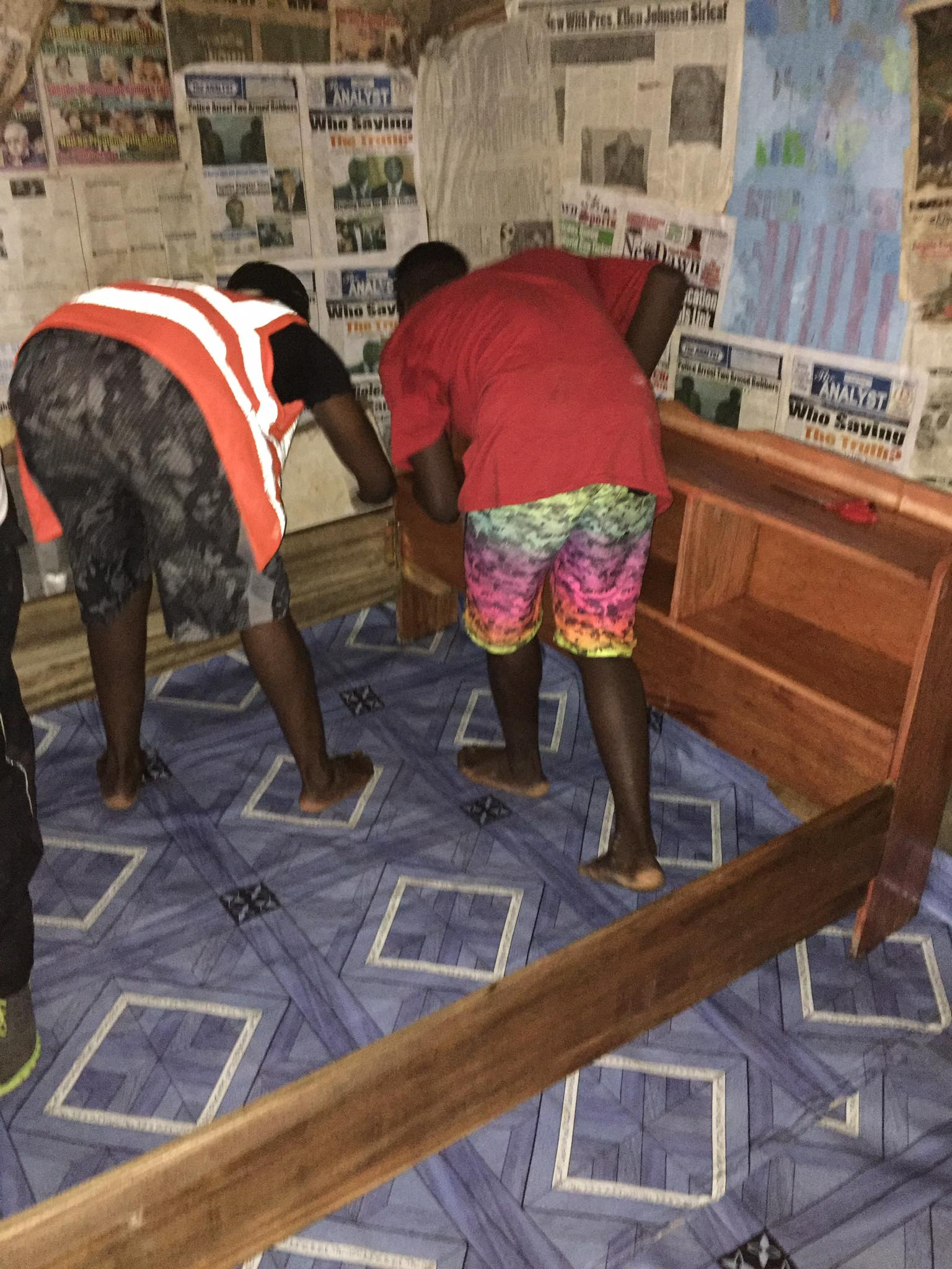 Our Volunteer Team puts down new vinyl flooring, then assembles the bed.