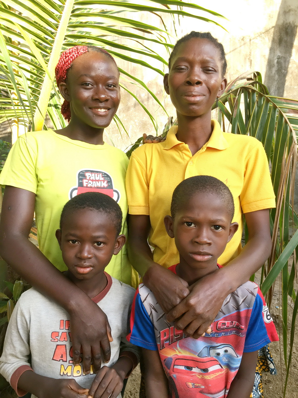 Maybe and her children are happy to be resettled in Liberia