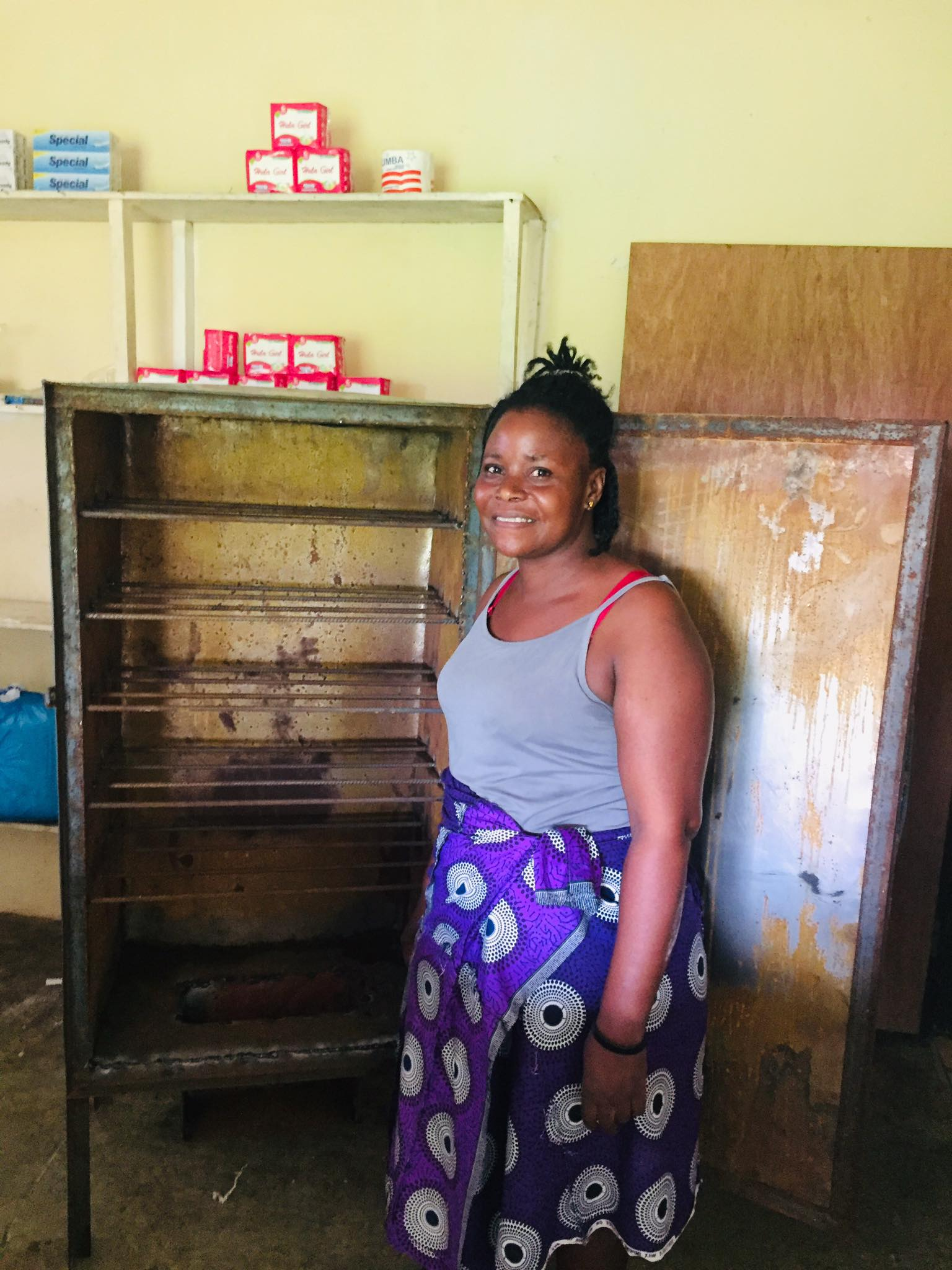 This is Korpu our new mother in Ma Esther's Home. She is standing by the new oven we purchased for her.  Nancy has the same oven.