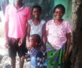 Mother Louisa and her children. Their house has been marked as one of the first homes to be demolished. This family has been here a long time. They suffered much, yet they are grateful to God for keeping them alive!