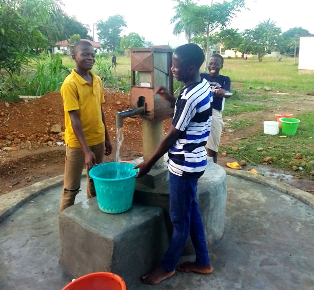 Shortly after John and Korpu moved in we put in a new well at Ma Esther's. The children show their happy faces pumping an abundance of water!