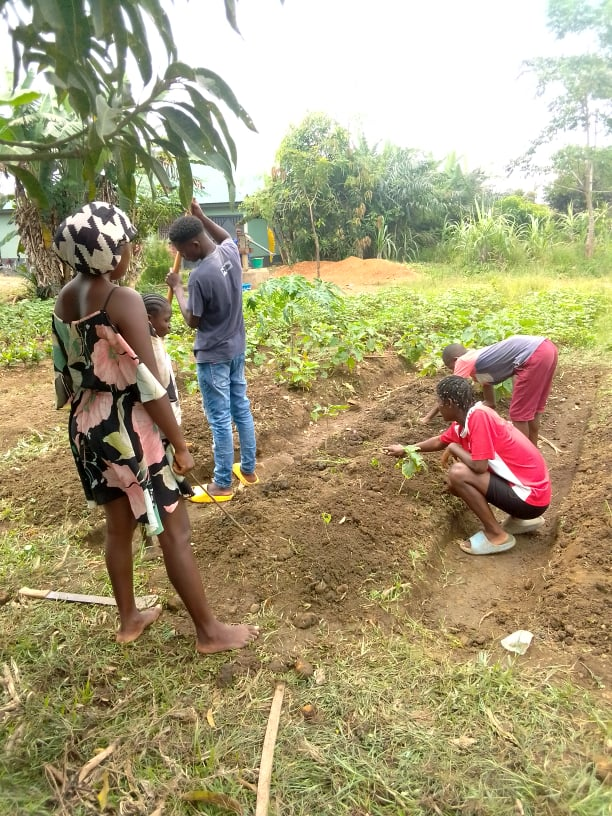 John is a master gardener.  He runs his own NGO called Agriculture Conduit for Transformation.  This is a means to provide sustainability to those in rural areas through organic gardening.  He is passionate to be training the children how to garden.